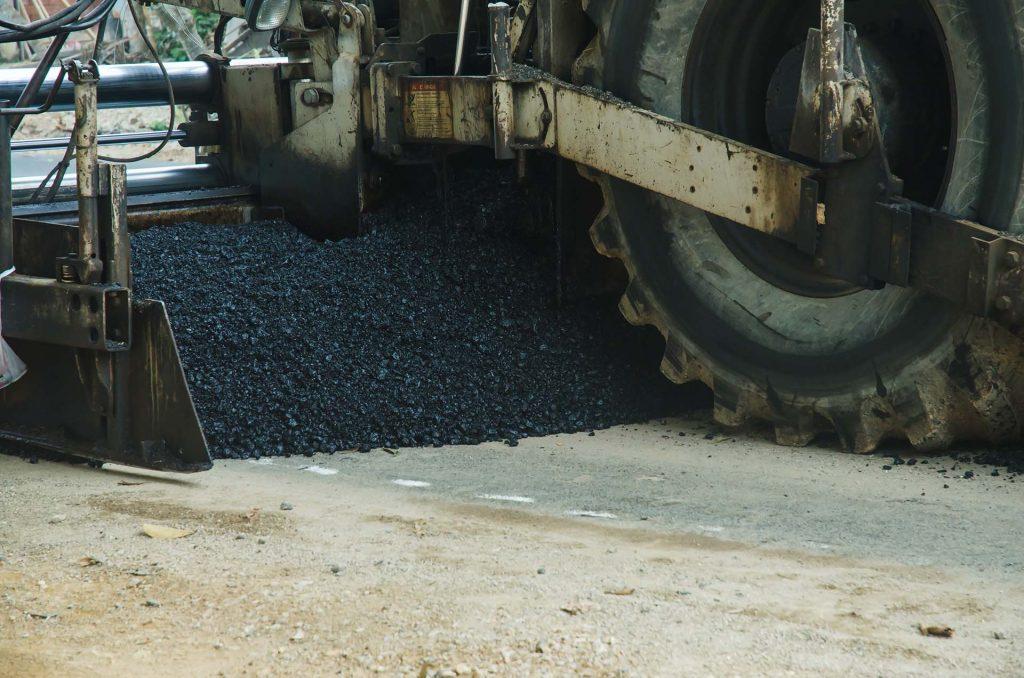 Road roller machine works on the fresh asphalt, Asphalt road construction